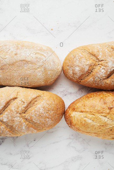 Top down view of fresh baked country style loaves of bread