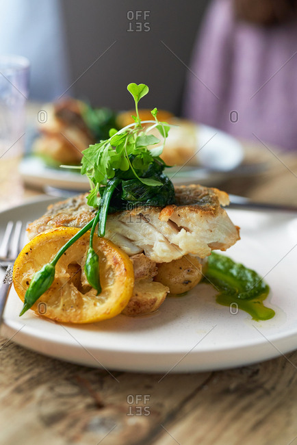 Baked cod with watercress sauce and wild garlic served with new potatoes