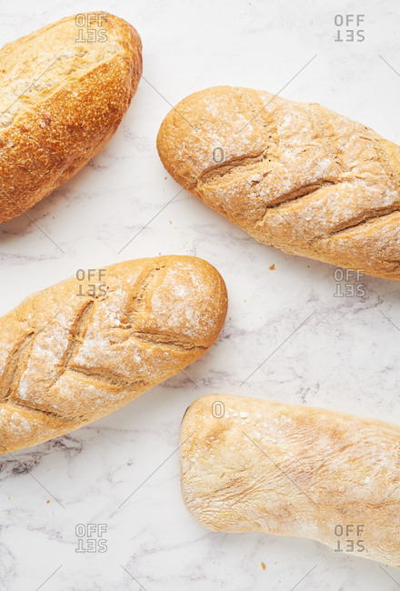 Top down view of loaves of fresh baked artisan bread arranged in chevrons