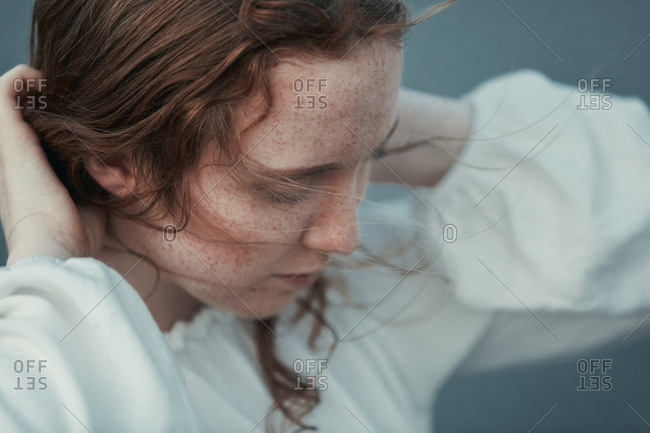 Freckled teenage girl at the sea