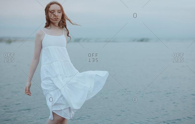 Redhead teenage girl at the sea