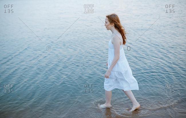 Redhead teenage girl in the sea