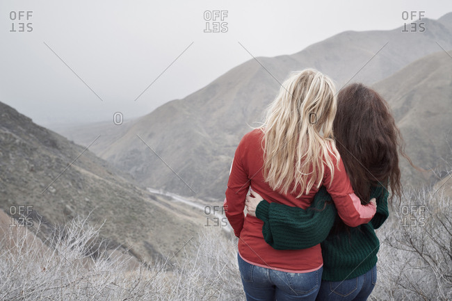 Two women hugging at the rocky mountains