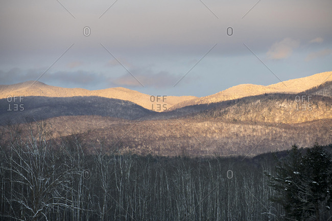 Late afternoon sunlight on snow-covered Green Mountains in Brandon, Vermont