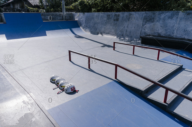 Canggu, Bali, Indonesia - March 19, 2018: Helmets in a row at a skate park