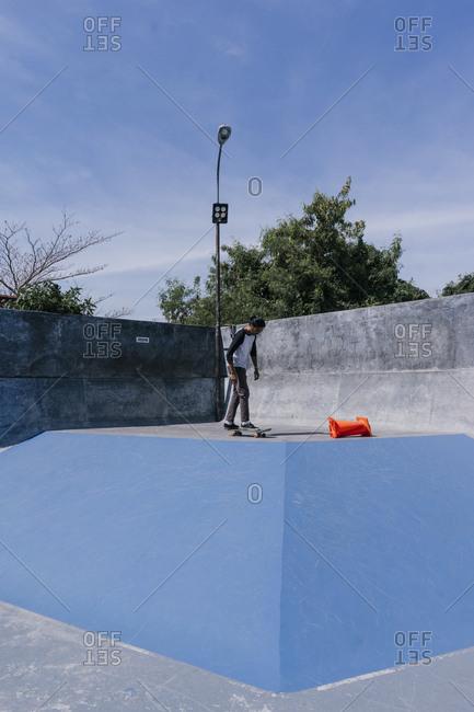 Canggu, Bali, Indonesia - March 19, 2018: Young man at a skate park