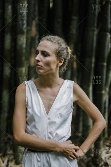 Woman wearing white romper looking away