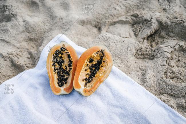 Overhead of a papaya on a beach