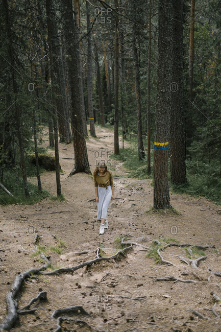 Blonde woman hiking in the woods