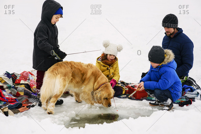 Family ice fishing together