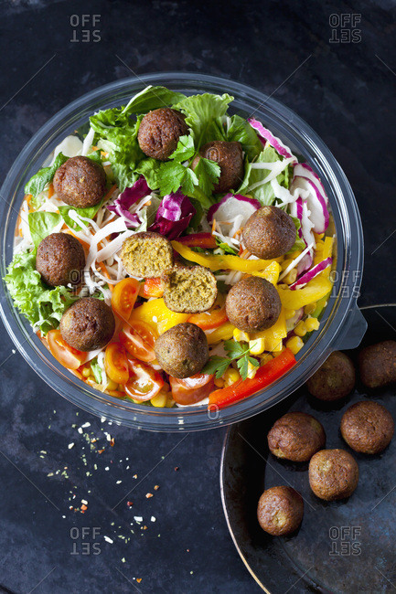 Bowl of mixed salad with vegetable balls