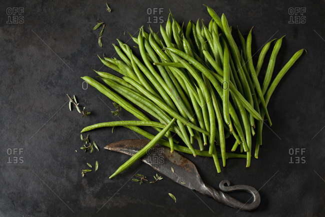 Needle beans- savory and an old knife on dark metal