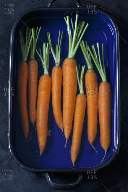 Raw carrots in a roasting tray
