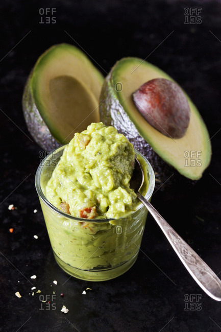 Glass of Guacamole and sliced avocado