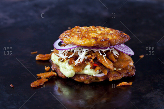 Veggie Burger made of potato fritters-  sweet potatoes- soy meat- remoulade and Barbecue sauce
