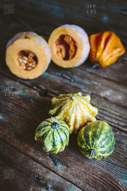 Various ornamental pumpkins on wood