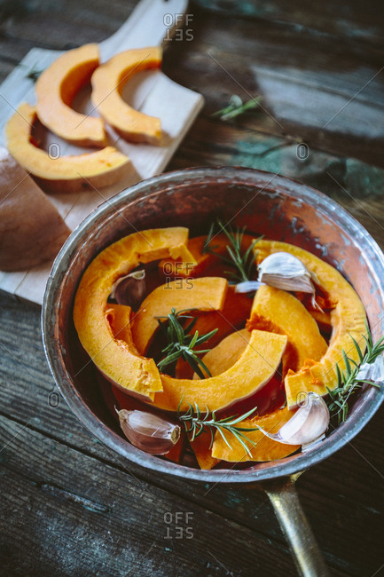 Pumpkin slices- garlic and rosemary  in casserole