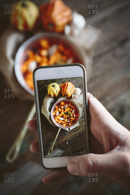 Taking photo of casserole of pumpkin dish with smartphone