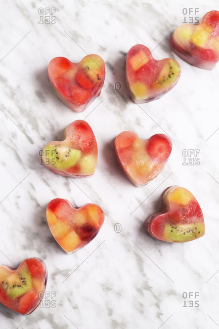 Homemade heart-shaped ice cubes on marble