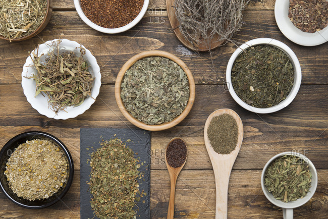Various herbal infusions on wood- chamomile- mint- rooibos- thyme- green tea- tisane