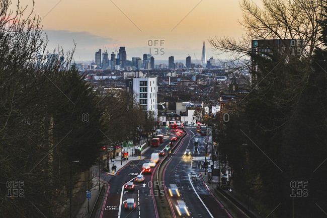 UK- London- panoramic view of the city with busy street on foreground at sunset