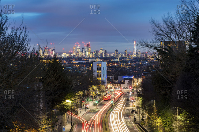 UK- London- panoramic view of the city with busy street on foreground at dusk