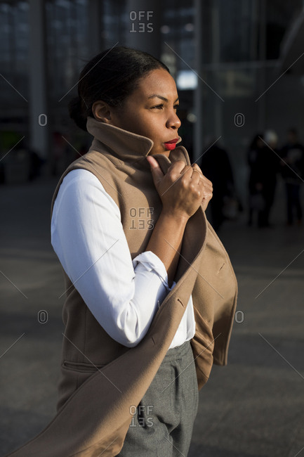 Fashionable businesswoman at evening sunlight