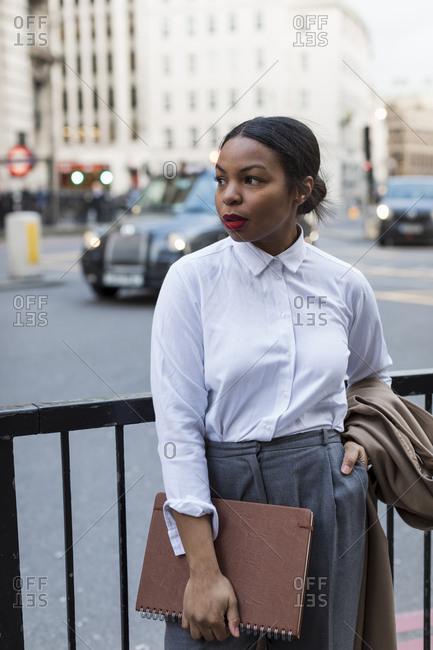 UK- London- businesswoman waiting