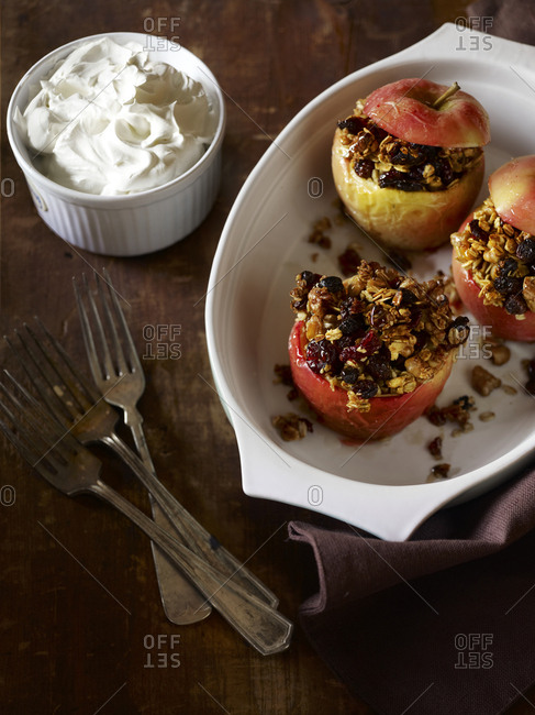 Baked Apples with crumble inside and a side of cream