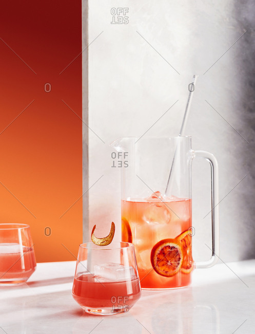 Pitcher and glass of blood orange cocktail