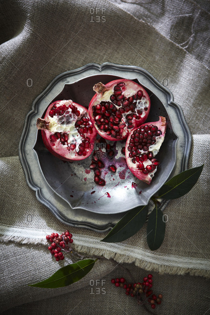 Pomegranate halves in a bowl