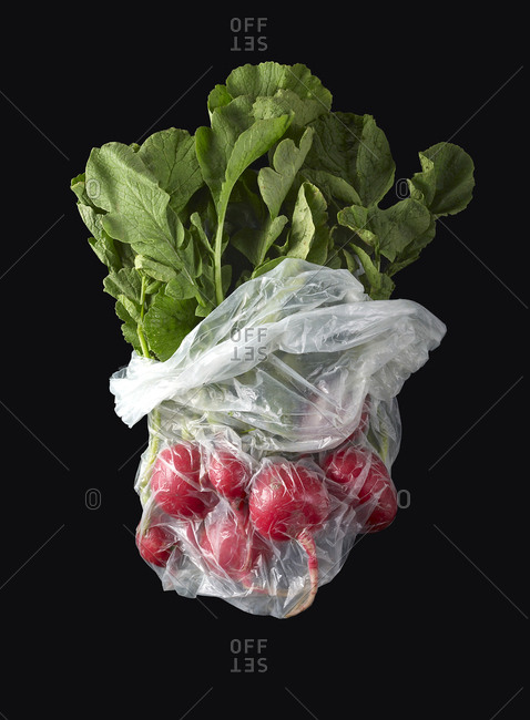 Bunch of radishes in plastic bag