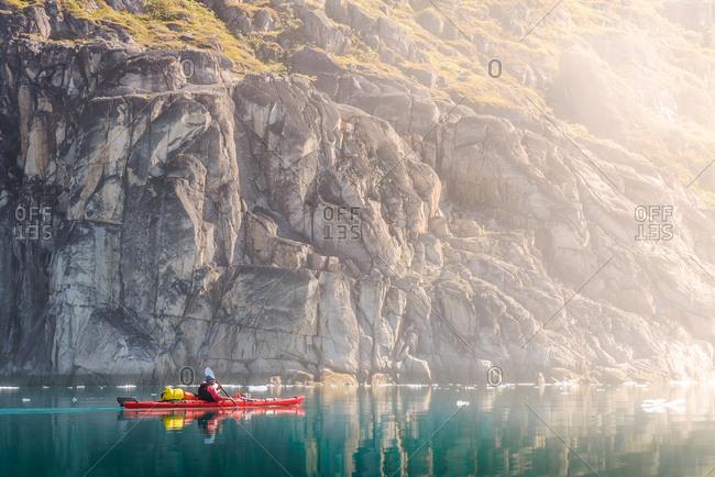 Man sea kayaking, Narsaq, Kitaa, Greenland