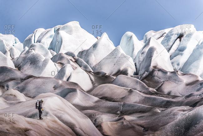 Man exploring Qualerallit glacier, Narsaq, Kitaa, Greenland
