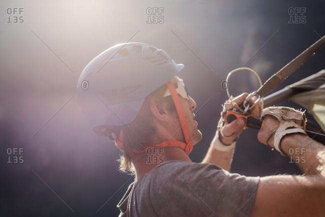 Rock climber securing portaledge, close-up, Liming, Yunnan Province, China