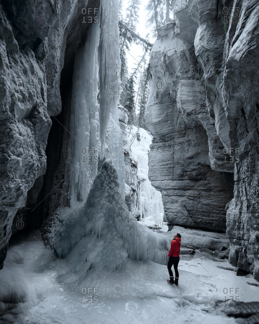 Woman exploring Maligne Canyon, Jasper National Park, Alberta, Canada
