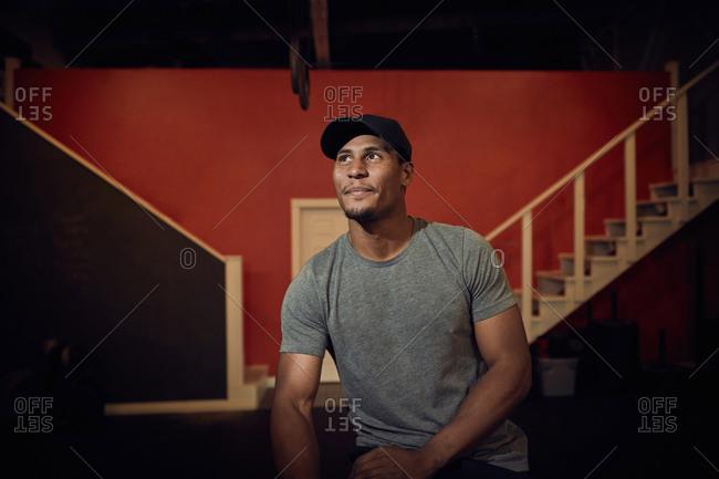 Portrait of man in baseball cap looking away