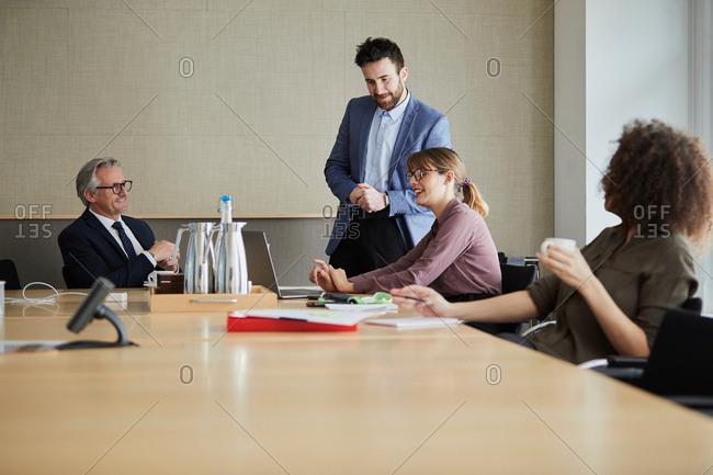 Colleagues in meeting in boardroom
