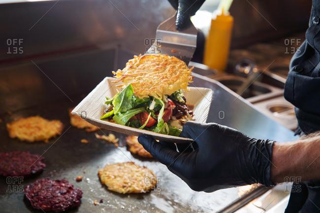 Cook preparing takeaway food