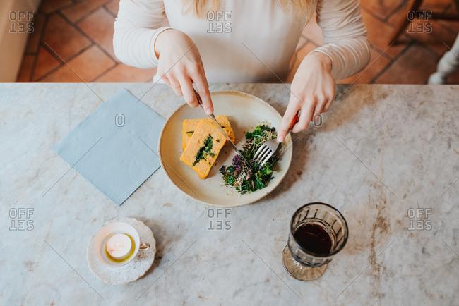 Woman having vegan meal in restaurant