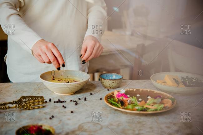 Woman preparing vegan dish