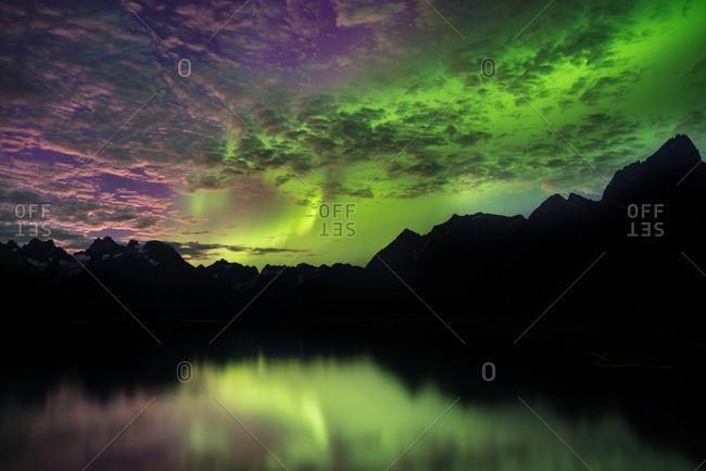 Aurora Borealis above mountain ranges, Narsaq, Vestgronland, Greenland