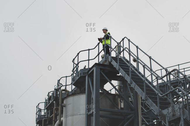 Industrial worker using a digital tablet on site