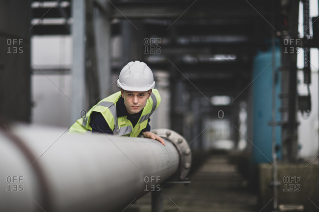 Industrial worker checking pipeline
