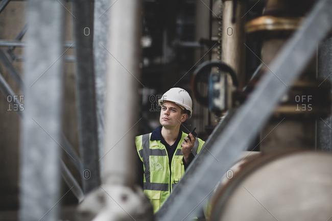 Industrial worker using radio on site