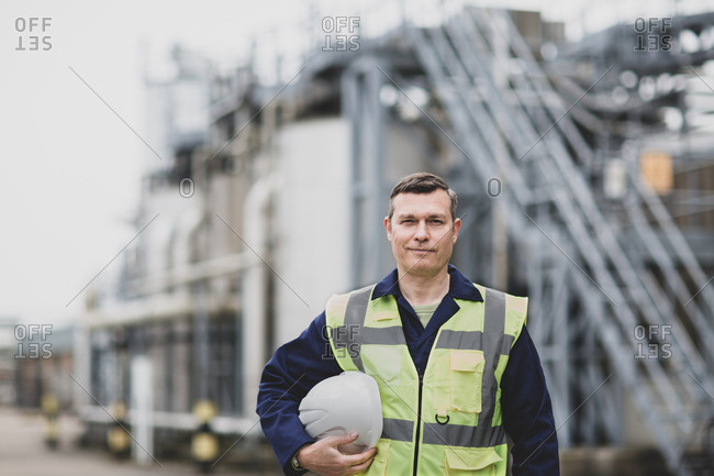 Portrait of mature industrial worker on site