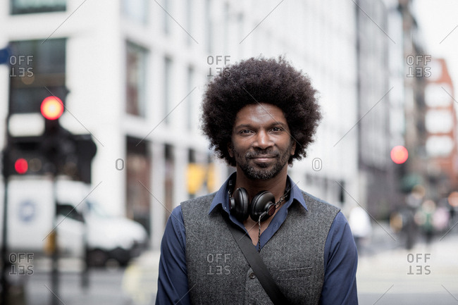 Portrait of African American male outdoors in city