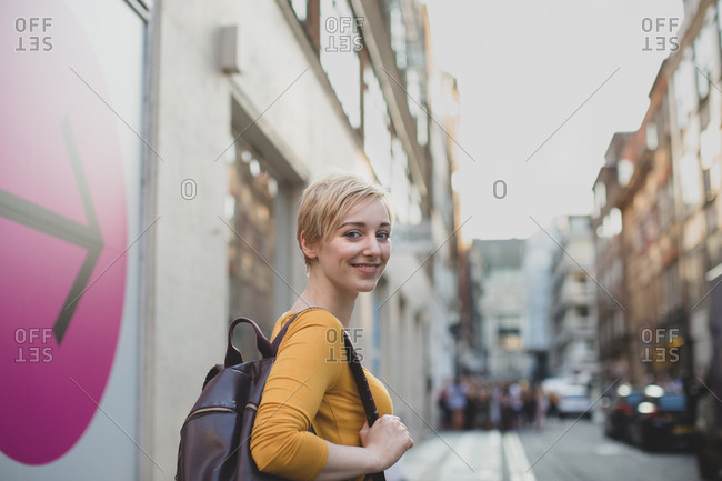 Young adult female walking down street