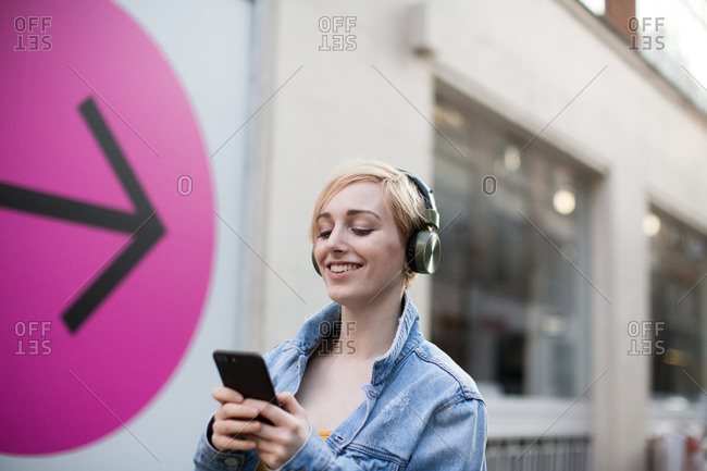 Young adult female streaming music