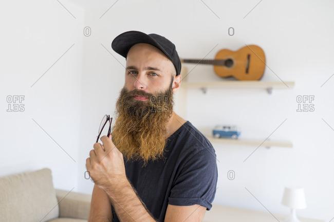 Portrait of bearded young man wearing baseball cap